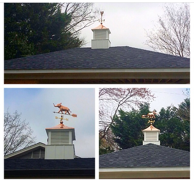Beautiful new cupolas and weather vanes installed on a new garage roof.